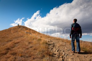 Man looking on peak of mountain